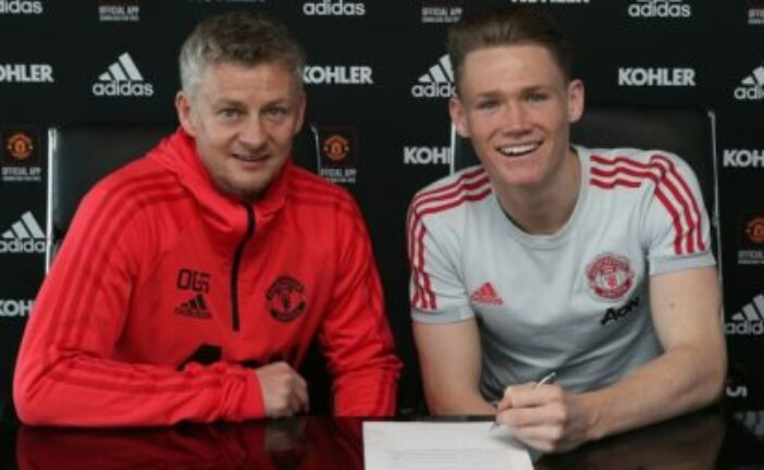 Photo: classy midfielder all-smiles after agreeing deal with Manchester United